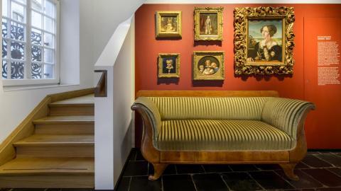 sofa, framed artwork